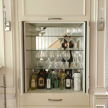 Rosedale Client is Thrilled with New Custom Built In Cabinets and Concealed Bar
