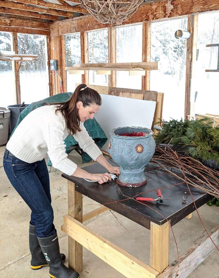 Design for Conscious Living - Handmade Seasonal Décor - Celia Resurfaces a Planter with Grapevines - CELIA GLUING VINES WITH THE GLUE GUN