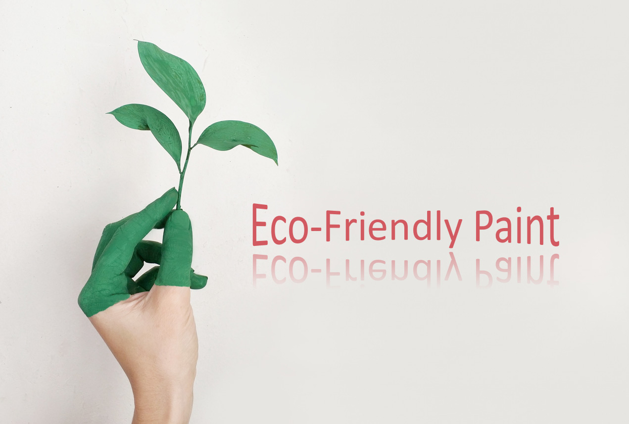 A woman's hand holding a stem with leaves all dipped in green paint with the title Eco-Friendly Paint.