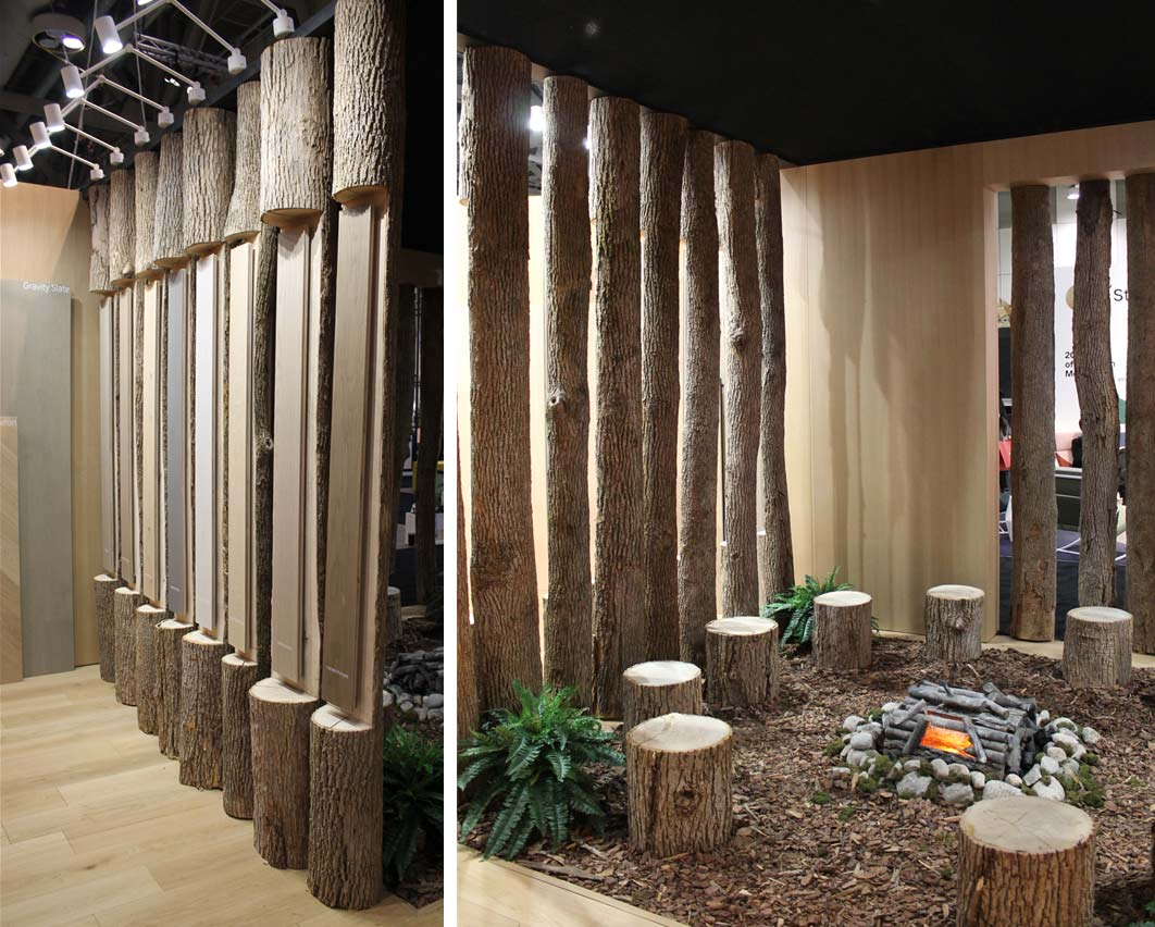The PurParket booth at IDS 2020 with stumps around a faux campfire and taller logs to display the wood flooring.