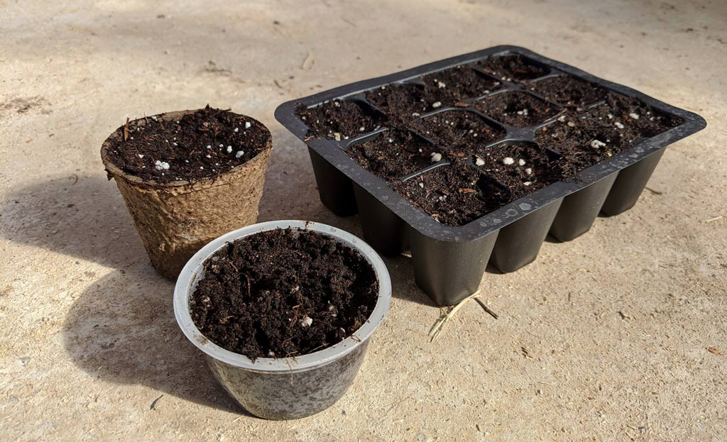 A photo of three different types of seeding pots.