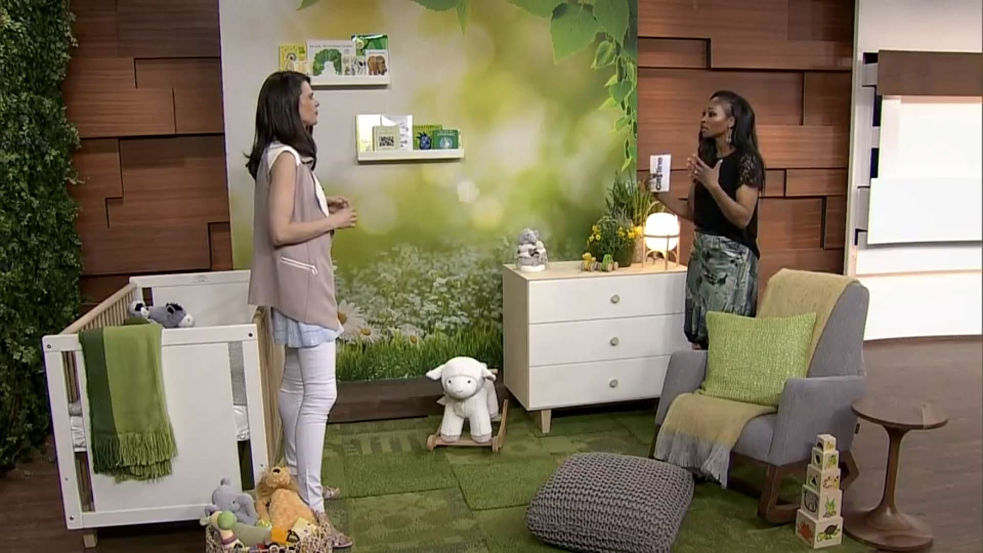Celia and Tracy standing in the nursery and discussing the design elements on the set of Cityline TV.